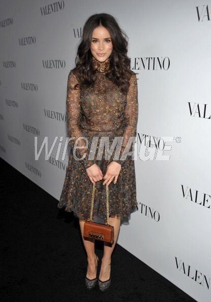 abigail-spencer-and-valentino-va-va-voom-studded-leather-convertible-clutch-gallery